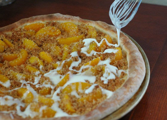 Icing on Peach Crumble Dessert Pizza